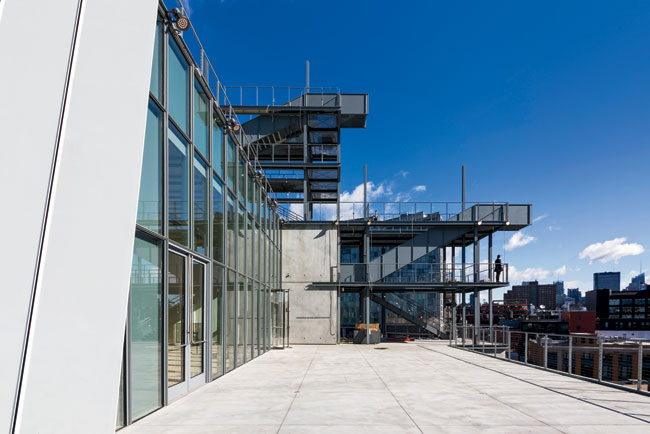 Steel stairs allow visitors to go from one outdoor art terrace to another.