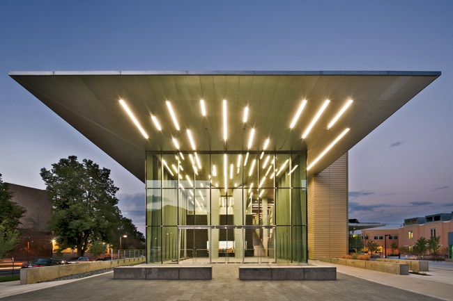 A 60-foot cantilevered canopy welcomes visitors to Marquez Hall at the Colorado School of Mines. Classrooms and lab spaces are visible behind the glass entry.