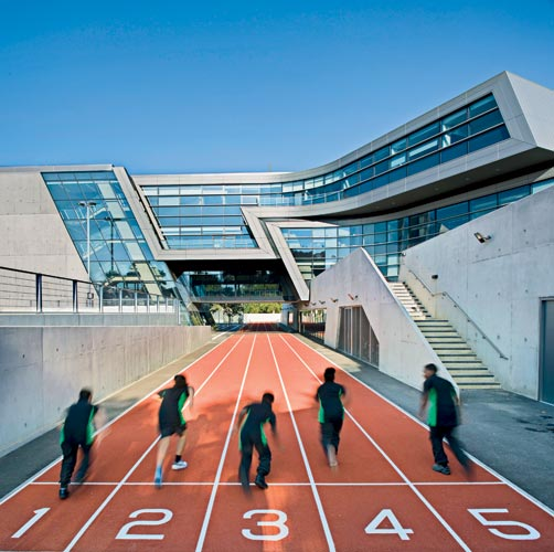 A 100-meter running track bisects the campus and links its two entrances.