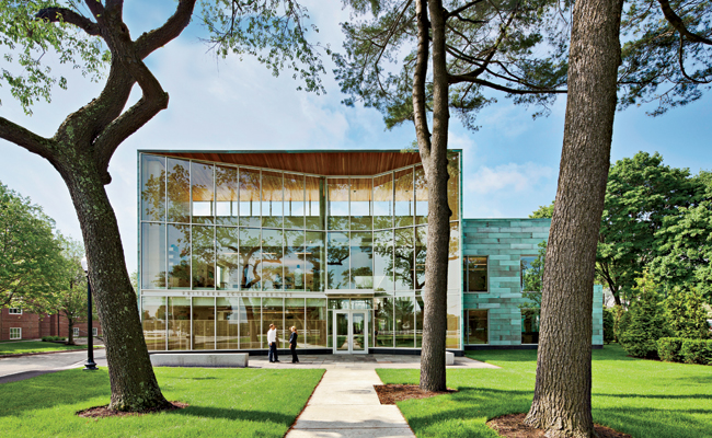 A glass facade calls out the front door and connects to the campus green. The curtain wall is angled to greet visitors arriving from different directions.