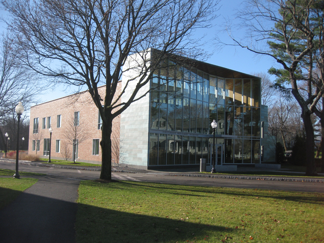 The headmaster's house reflects off of the science center's front facade.