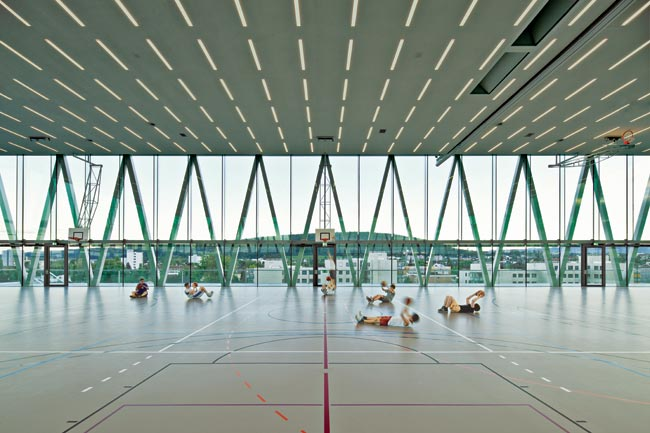 To moderate heat loads, the top-floor gym is outfitted with an automatic shading system and a ceiling that vents.