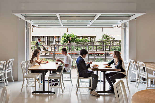The third-floor cafeteria features an enviable dining perch for middle- and high-school students that opens to the High Line with glazed overhead doors.