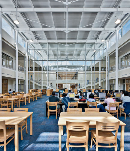 The new media center occupies a space at the school's core that was once a gloomy and low-ceilinged cafeteria.