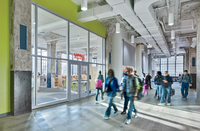 The architects balanced new and old by maintaining as much of the existing structure as possible and exposing its rough elements so students could experience the power of design every day. Transparent