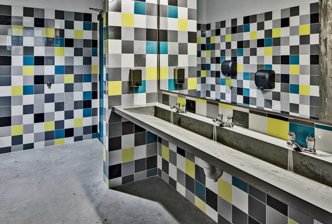 The interior fit-out and furnishings of the BDS are not your standard school-grade fare. The finely crafted,  concrete restroom sinks were designed and donated by the Baltimore-based Luke