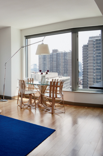The 1,100-square-foot, two-bedroom 'Frank unit' on the ninth floor is outfitted with furniture designed by the architect, like a coffee table and 'Hat Trick' table and chairs.
