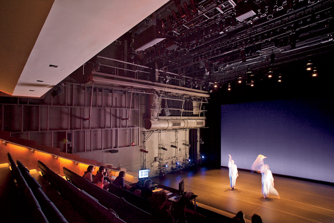 The steep rake provides excellent sight lines to the open, flat-floor stage, a configuration that reinforces an intimate relationship between performer and audience.