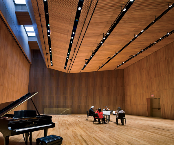 More salon than rehearsal space, Cary Hall features bamboolike red oak panels, comfortable red oak sprung floors, and daylight that filters through soundproof skylights to provide a soothing environme