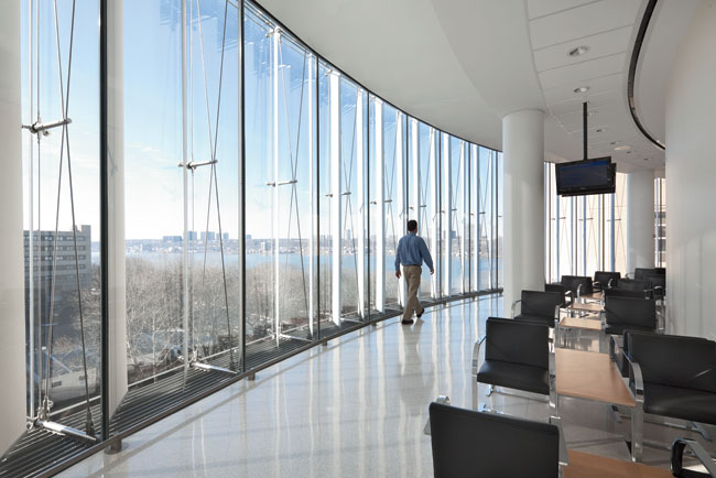 The cable-truss-supported, double-walled facade gives waiting rooms a clear view of the Hudson.