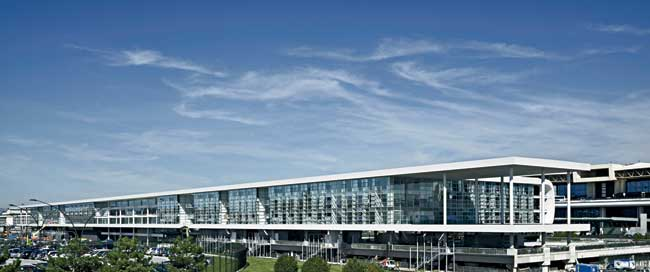 The Sheraton stretches along the entire length of the airport terminal, so that its elongated west facade is what drivers see from the road.