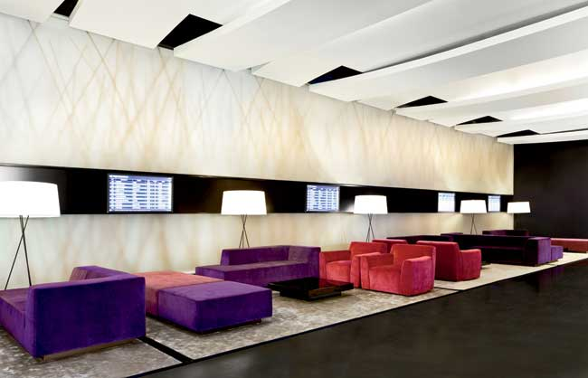 Cool and serene, the lobby features bamboo-backed shadow walls made of soft PVC panels, and King Roselli'designed furnishings. Wallmounted flight boards keep guests in touch with the adjacent airport,