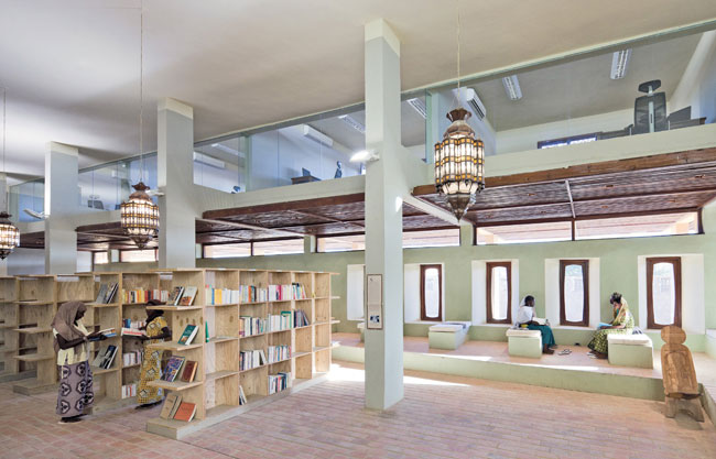 Staff offices overlook the airy spaces of the library, with suspended votive lamps characteristic of North African designs. The growing collection of contemporary books on the culture and history of t
