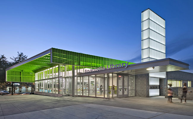 On the main entrance plaza, the Freelon Group gave the District of Columbia's Anacostia Library a 17-foot-high glass curtain wall shielded by a perforated metal canopy; its function is highly legible