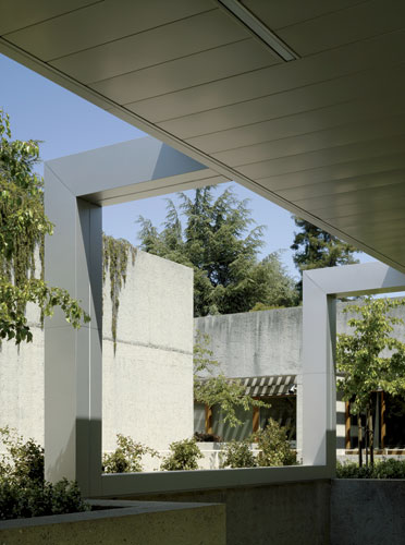 New, light steel canopies, beams, and columns alternate with original poured-concrete walls on various levels.