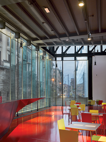A caf' on the upper level offers views of the Via Nizza and Via Cagliari, the corner where people enter the museum addition.