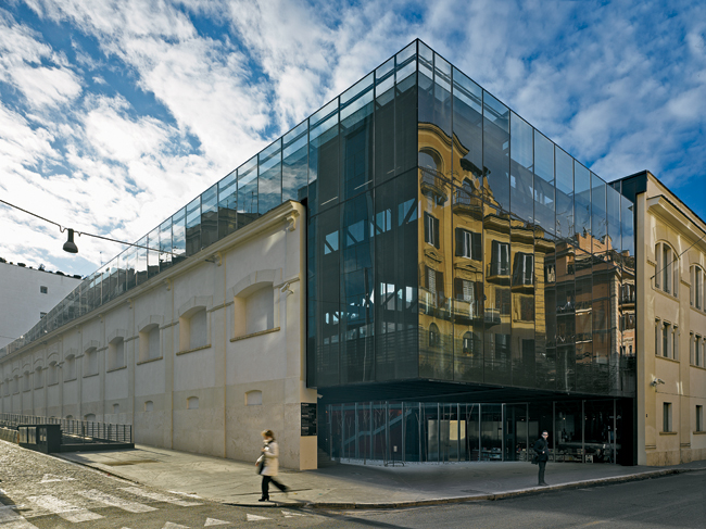 Decq and her team gutted the interior of an old Peroni brewery, cleaned up a pair of corner facades, and inserted their glass-and-steel structure within the existing fabric. Visitors enter the museum