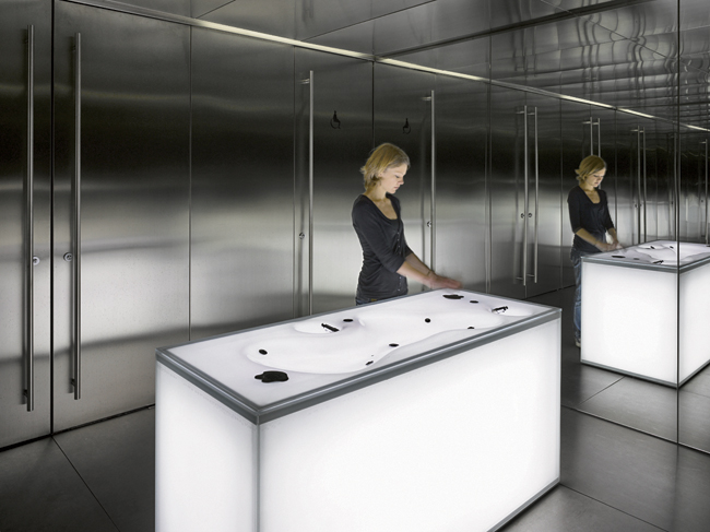 Translucent lavatories in the restrooms glow from within and can change color, making the simple act of washing one's hands a memorable experience.
