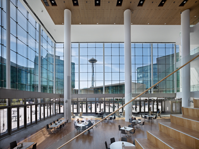 The atrium serves multiple functions, from eating or socializing to presentations for several hundred people.