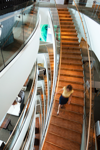 By using larger glass smoke skirts and extra sprinklers, NBBJ was able to keep staircases open for six flights.
