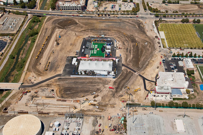 After three hiatuses and a site switch, construction of the stadium began in April. Rather than relying on the more typical 'racetrack' oval sequencing, the design-build contractor has split the site