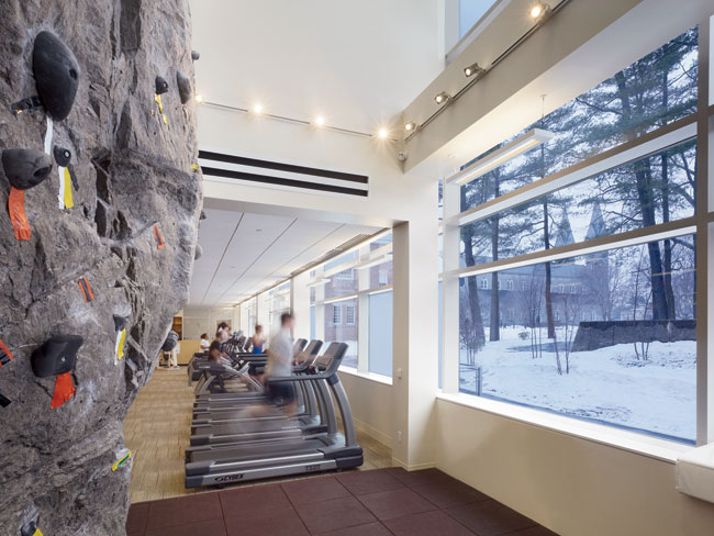 In the main floor exercise room, students can scale the climbing wall (at left), which imitates local granite.
