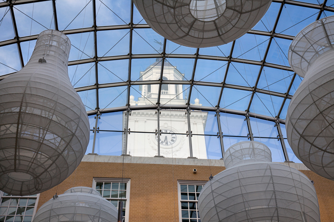 Diaphanous, gourd-shaped sculptures by artist Kendall Buster are suspended from the atrium's tension-grid glazed roof.