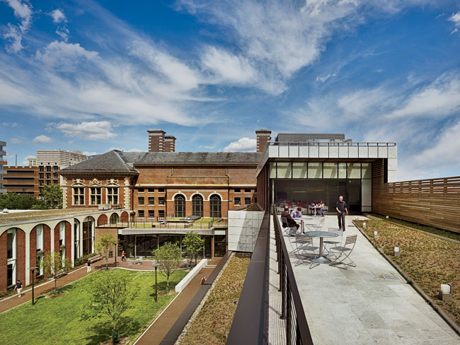 Part of KVA's project, a renovated, skylight-capped lounge on the east side of the courtyard (left, background), connects Golkin Hall to other Penn Law buildings on the ground level. Its green roof pr