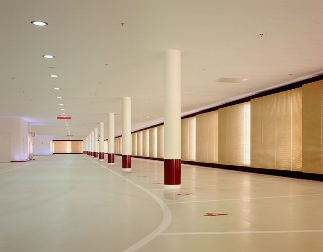 Architect Marco Serra also designed the company's underground parking facility, accessed within and around his reception pavilion.  Here Licht Kunst Licht grazed the textured, champagne-colored stainl