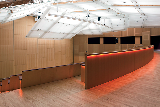 Below grade, a 600-seat auditorium can be divided into two sections. It features: a wood-lined acoustical wall perforated with a subtle graphic pattern by the New York'based graphic design firm 2x4; a