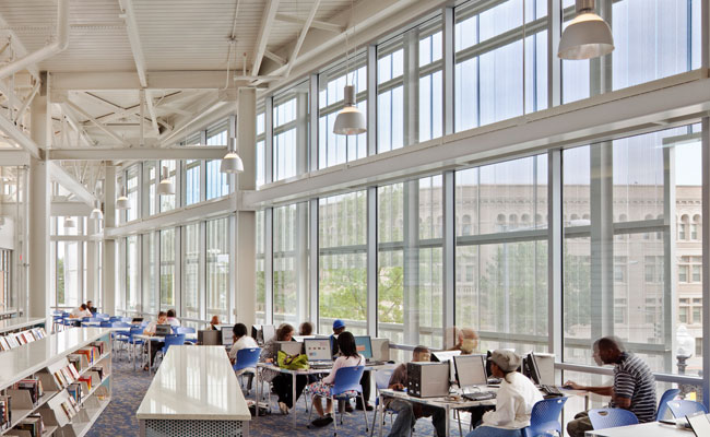 As a decorative note, architects Davis Brody Bond and the lighting designers at MCLA installed industrial-style pendants outfitted with compact fluorescent lamps in the daylight-filled reading room. O
