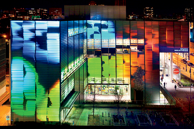 Bernard Duquay created an animated video that wraps the aluminum and glass facade of the Grande Bibliothéque, circa 2004.