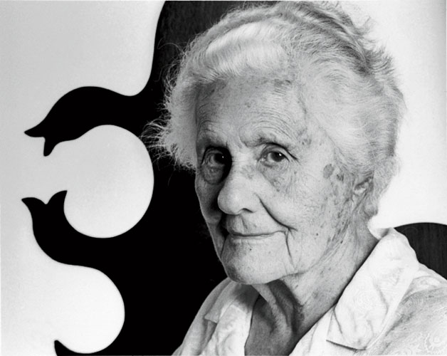 Eva Zeisel, shown here in 2006 in front of a pattern of her own design, died in December 2011 at the age of 105, one year after she began working on her last project.