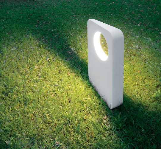 Part sculpture, part path light, Artemide's Eraclea is a die-cast concrete trapezoidal monolith with a round aperture that casts bidirectional light. The unit measures 20' wide x 31½' high and