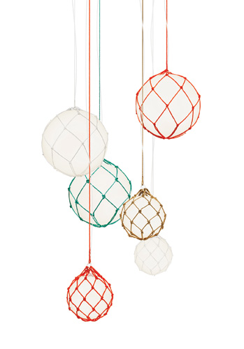 Newly available in the U.S. through Global Lighting, Fisherman Pendant is a whimsical design by the Swedish lighting company Zero. The hand-knotted rope-cord nets'in white, orange, and natural beige,