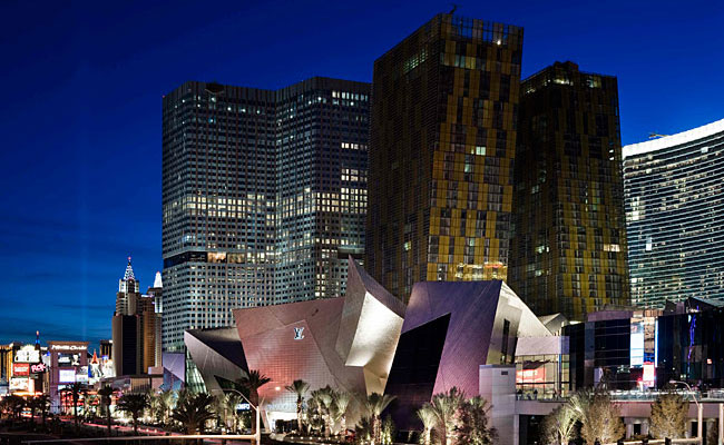 The stainless skin of Daniel Libeskind's Crystals retail complex reflects the color and light of the signage across the Strip.