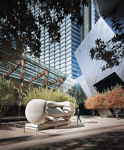 The Aria and the neighboring Daniel Libeskind'designed Crystals retail complex enclose an outdoor room. The sliverlike space, defined by the canted glazed wall behind the hotel reception desk and the