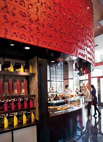 The Mandarin's Amore Patisserie, created by Tihany Design, relies on a palette of strong reds and inky blacks. Its textured panels, crafted from painted glass-fiber-reinforced gypsum, feature the sign