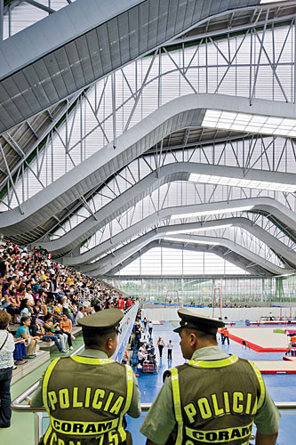 Daylight streams into the arenas through polycarbonate-clad clerestories, which are created by the roof's topography.
