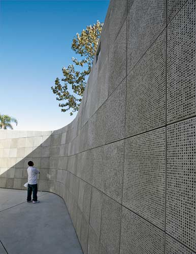 An outdoor room serves as a memorial for the 1.2 million children killed during the Holocaust. Each child is acknowledged with a hole of a different size and depth punched into GFRC tiles wrapping aro