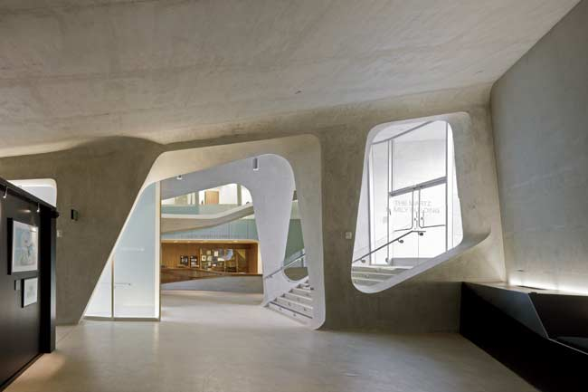 The architects created the curved vertical walls of the 36,000-square-foot museum by spraying shotcrete on metal frames and then troweling it. They used poured concrete only for the floors and roof.