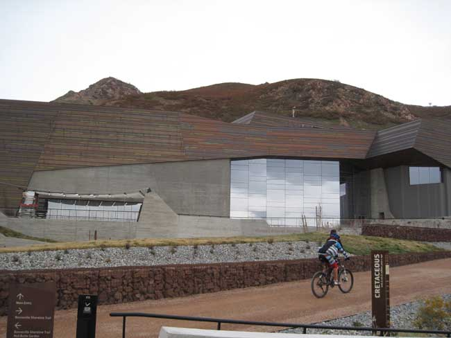 The building's site includes a trailhead for a popular mountain biking, hiking, and running path.