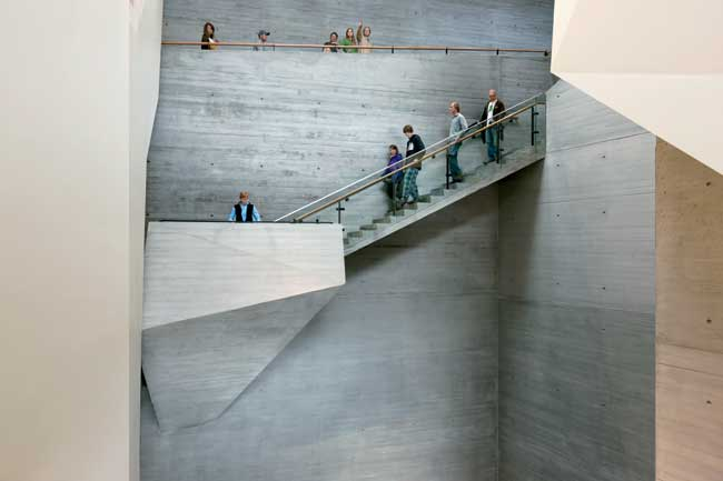A sculptural stair of board-formed concrete provides a vantage point for activity in the canyon—the museum's main social space.