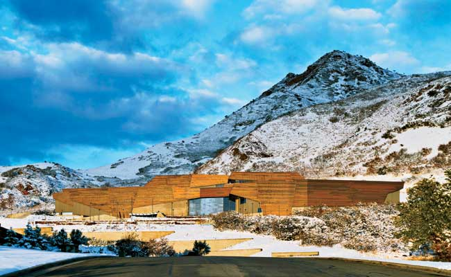 The museum, which sits in the foothills of the Wasatch Mountains at the edge of the University of Utah campus, is clad in panels made of three different copper alloys. Each is patinating differently,