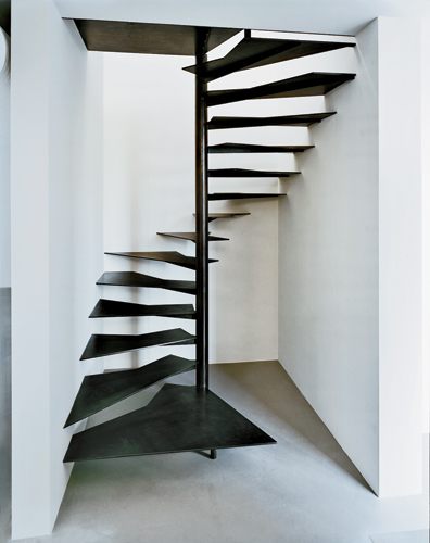 Inserted in a narrow space between two of the old sheds, a spiral stair leads to a small office for the foundation's president. Treads of 3/8-inch-thick blackened steel are attached to a 4-inch-wide s