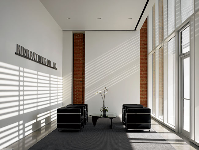<strong>Community Lounge</strong> Just beyond the dramatic entry through the brise-soleil, the reception area provides a quiet pause before the procession down the central hall. The architect has left