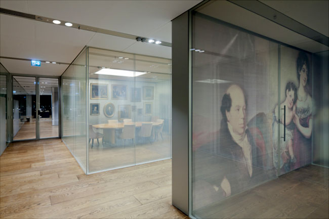 In a modern take on portraiture, large-scale depictions of members of the Rothschild family are printed onto silk scrims.