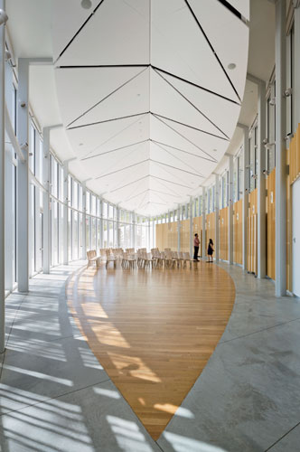 The 2,500-square-foot event atrium can hold 200 people and accommodate both talks and parties. Wood panels along the north side of the space were made from ginkgo trees that were cut down to make way