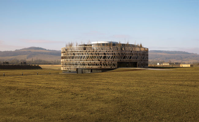 2,060-year-old battlefield On the site where Julius Caesar laid siege to Gallic leader Vercingetorix, Bernard Tschumi has created a circular concrete orientation center wrapped in a wood lattice.