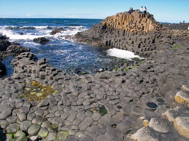 Formed by volcanic activity 50 million years ago, the Giant's Causeway  comprises over 40,000 polygonal columns up to 39 feet tall. In legend it is said to be the vestige of a bridge to Scotland built
